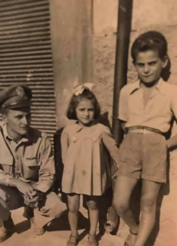 86th-FS-Reidy-E.-Jones-with-Sicilian-children.-John-McNeal-collection-via-the-McNeal-Family