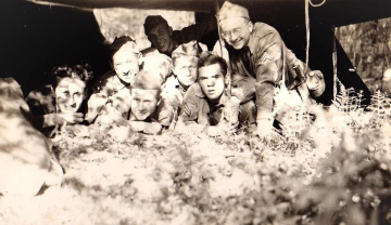 86th-FS-John-R.-McNeal-on-ground-far-right-while-in-Pennsylvania-National-Guard.-John-McNeal-collection-via-the-McNeal-Family