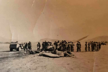 86th-FS-Clifford-Sachleben-85th-FS-Carl-Simpson-P-40-after-landing-accident.-John-McNeal-collection-via-the-McNeal-Family