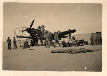 79th-FG-P-40-undergoing-maintenance-in-the-desert.-AFHRA-photograph