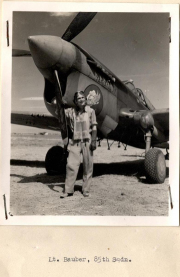 85th-FS-Richard-Bunker-likely-no-Lt.-Bauber-with-the-79th-FG-beside-a-P-40-named-Sand-Fly-3rd.-AFHRA-photograph