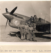 85th-FS-Thomas-Cox-sitting-on-wing-wearing-flight-jacket-and-his-crew-with-his-P-40-named-The-Crump-Machine-X36.-AFHRA-photograph