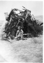 85th-FS-armorer-Harold-Fogg-in-Sicily-with-wrecked-P-40.-James-Connors-collection-via-John-Connors