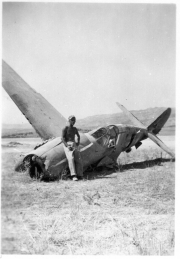 85th-FS-armorer-Victor-Kolar-in-Sicily-with-wrecked-P-40.-James-Connors-collection-via-John-Connors