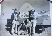 85th-FS-pilot-George-Rocky-Blare-and-others-by-the-tail-of-likely-John-Martins-P-40.-Charles-Grogan-collection-via-Steve-Grogan