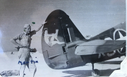 85th-FS-pilot-John-Martin-by-the-artwork-that-likely-was-on-his-P-40-X37.-Charles-Grogan-collection-via-Steve-Grogan