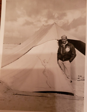 85th-FS-pilot-Tom-Cox-in-front-of-Lt.-Hoaglands-tent.-Samuel-L.-Say-collection-via-family