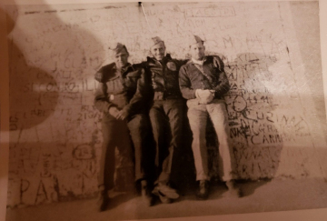 85th-FS-pilots-John-Martin-Tom-Cox-and-William-Ryburn-on-top-of-the-Marble-Arch.-Samuel-L.-Say-collection-via-family