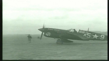 86th-FS-P-40-X59-named-Sweet-Eloise-at-Capodichino-Naples-Italy-January-1944.-Still-from-USAAF-film