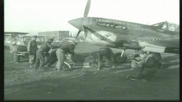 87th-FS-Albert-Lincicomes-P-40-X98-named-HONTY-TONKY-DONKY-at-Capodichino-Naples-Italy-January-1944.-Still-from-USAAF-film
