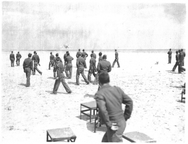 87th-FS-Philip-Bagian-downs-the-beach-volleyball-net-at-Cesenatico-Italy-4-May-1945.-Philip-Bagian-collection-via-Jim-Bagian