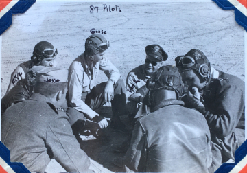 87th-FS-pilots-Jesse-Jory-Edward-Fitzgerald-and-Lee-Goose-Gossick-briefed-by-87th-FS-XO-Major-Ralph-Porter.-Charles-Grogan-collection-via-Steve-Grogan-